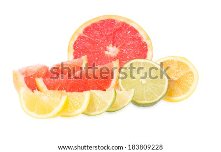Fresh grapefruits, limes and lemons lies on a white background - stock photo