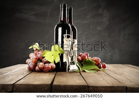 fresh grapes and bottle of wine  - stock photo