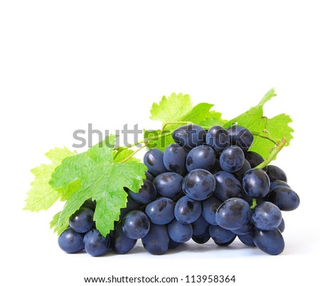 Fresh grapes brunch with green leafs - stock photo