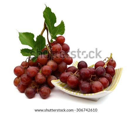 fresh grapes on plate isolated on white  - stock photo