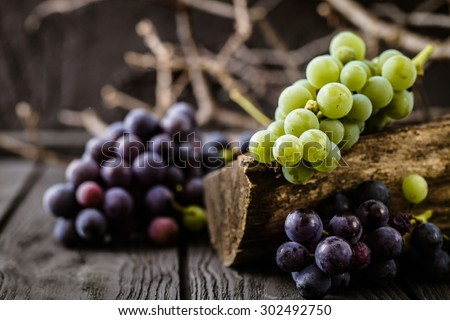 Fresh grapes on wood. Autumn fruit