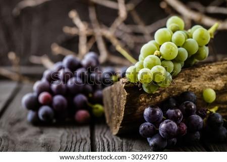 Fresh grapes on wood. Autumn fruit - stock photo