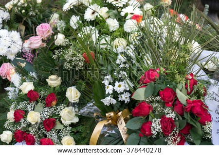 fresh grave site in a cemetery / Grave - stock photo