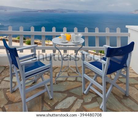 fresh greek breakfast at morning by seaside with caldera view, Santorini, Greece - stock photo