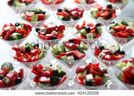 Fresh Greek salad in a bowls. Shallow depth of field - stock photo