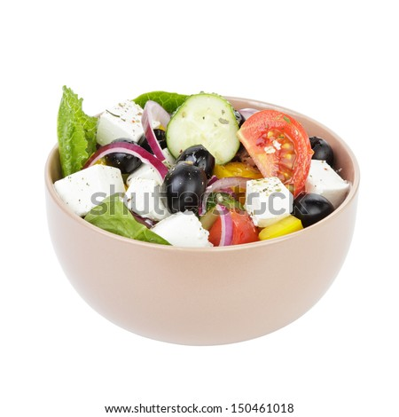 fresh greek salad in clay bowl, isolated on white - stock photo