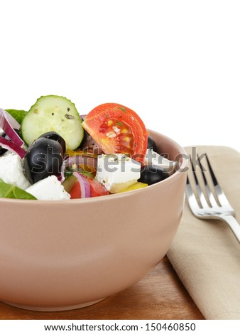 fresh greek salad in clay bowl, on table