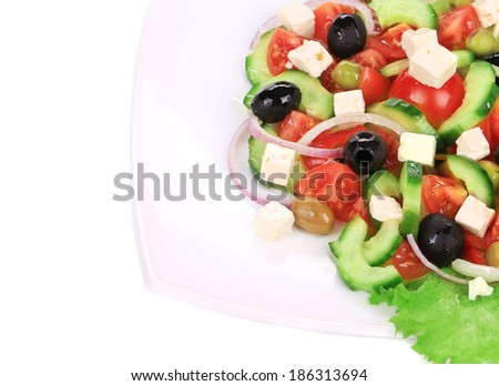 Fresh greek salad. Isolated on a white background.