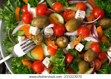 Fresh Greek salad on table.