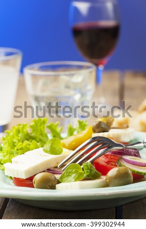fresh greek salad with olives  - stock photo
