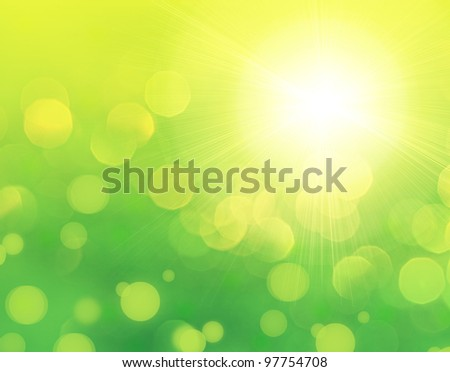 Fresh green abstract spring background with bokeh effect and sun light - stock photo