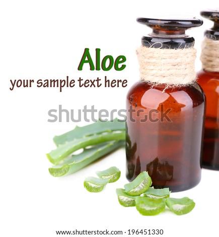 Fresh green aloe leaves and medicine bottles, isolated on white - stock photo