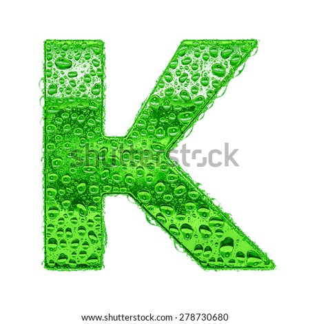 Fresh Green alphabet symbol - letter K. Water splashes and drops on transparent glass. Isolated on white - stock photo