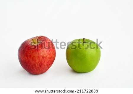 Fresh green and red apples for Rosh Hashanah Jewish holiday, on white background with copy space - stock photo