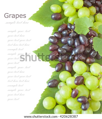 Fresh green and red grapes with leaves. Isolated on white