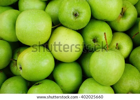 Fresh green apple background:Close up,select focus with shallow depth of field:ideal use for background. - stock photo