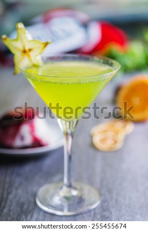 fresh green apple soft lemonade in a glass on a wooden table with decorations focus on different parts of the glass - stock photo