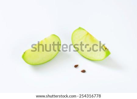 Fresh green apple wedges - studio shot - stock photo