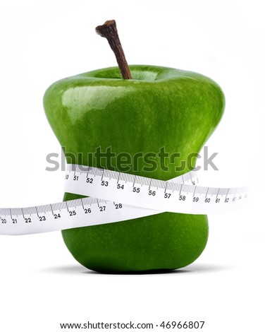 fresh green apple with measure tape over white - stock photo