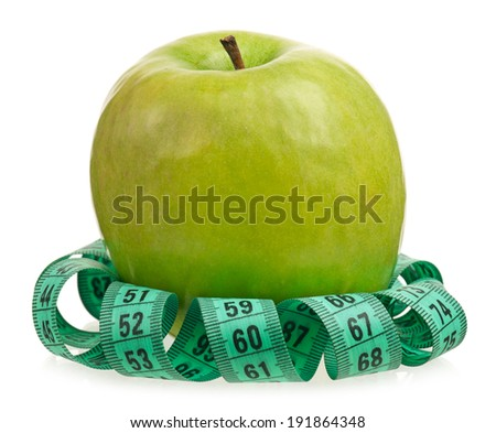 Fresh green apple with tape measure isolated on a white background - stock photo