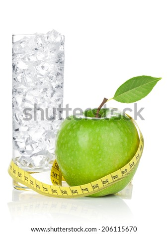 Fresh green apple with yellow measuring tape and glass of water. Healthy food. Isolated on white background - stock photo
