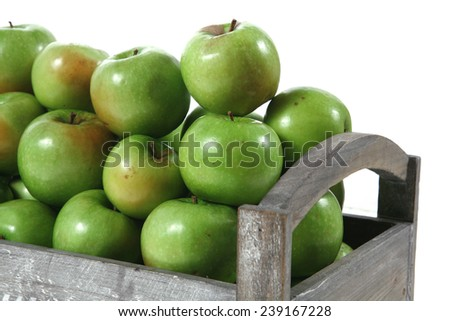 fresh green apples heap in vintage grey box ready to sell isolated on white background - stock photo