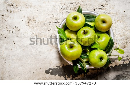 Fresh green apples in a dish on a rustic background.  Free space for text . Top view - stock photo