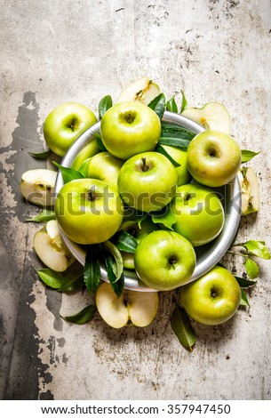 Fresh green apples in a dish on a rustic background.  Top view - stock photo
