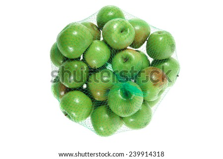 fresh green apples in green transport net ready to sell isolated on white background - stock photo
