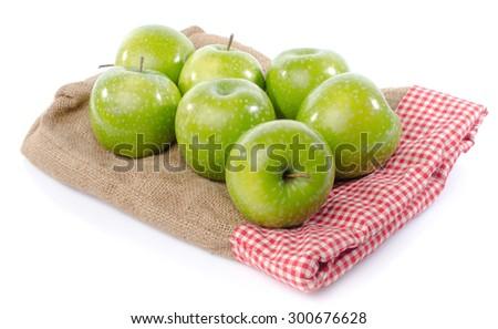 Fresh green apples on burlap bag, isolated on white - stock photo
