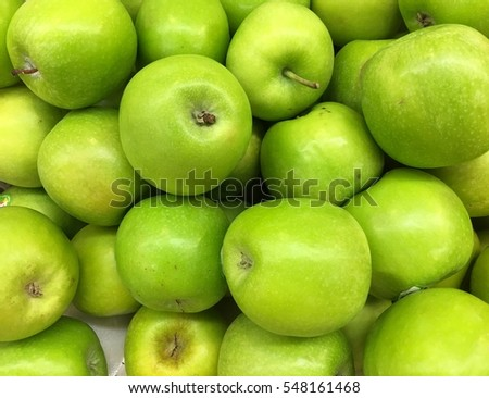 Fresh green apples ready for sale in a supermarket.