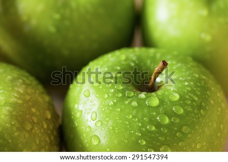 fresh green apples with water drop close up - stock photo