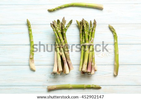 Fresh green asparagus on a blue wooden table