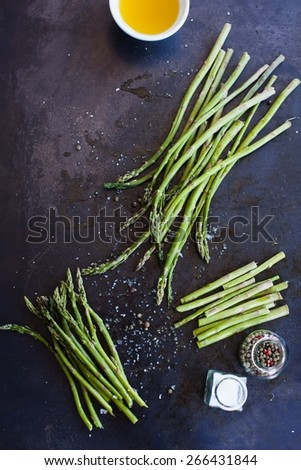 Fresh green asparagus on dark background. Low key - stock photo