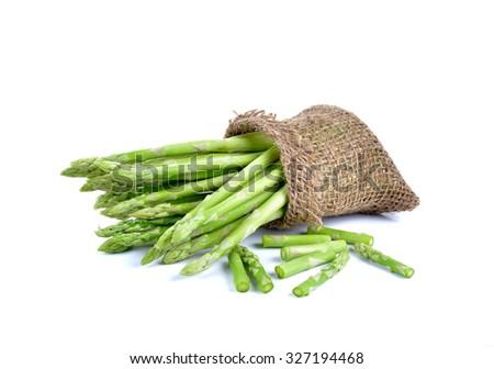 Fresh green asparagus on white background - stock photo