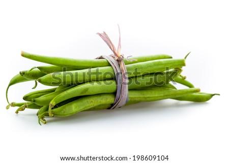 fresh green beans on a white underground - stock photo