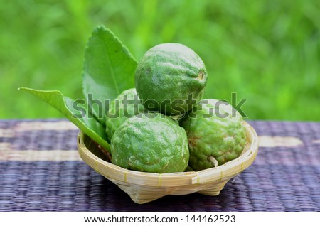 Fresh green bergamot fruit with great compose in basket