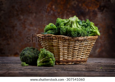 Fresh green broccoli in a basket, organic food - stock photo