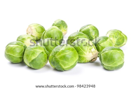 Fresh green Brussels sprouts isolated on white background - stock photo