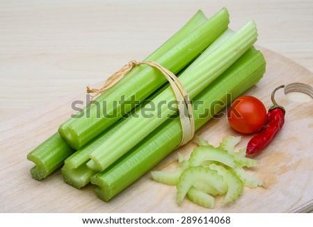 Fresh Green Celery sticks on the wood background - stock photo