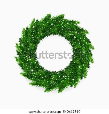 Fresh green Christmas wreath covered in snow
