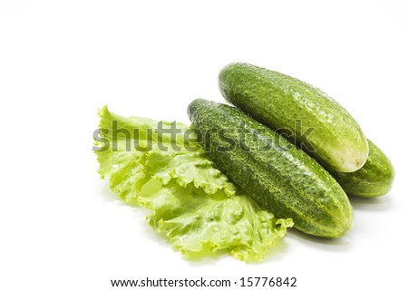 Fresh green cucumbers on lettuce