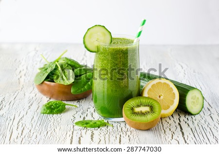 Fresh green detox smoothie on white wooden background, diet and health concept, vitamins - stock photo
