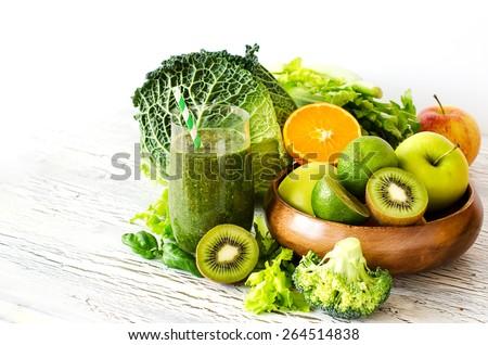 Fresh green detox vitamin  smoothie on white background for healthy snack - stock photo