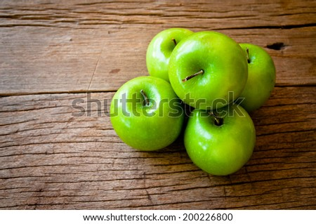 Fresh Green Granny Smith Apple On Wood Table Background, Rustic Still Life Style. - stock photo