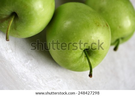 Fresh Green Granny Smith Apples on Stoneware Plate - stock photo