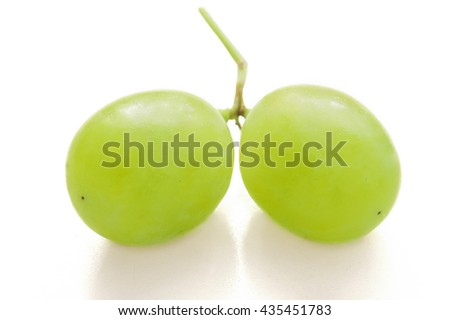Fresh green grapes macro. Isolated on white