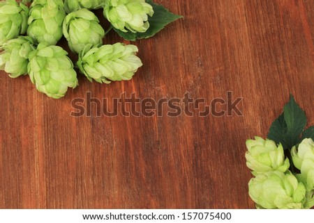 Fresh green hops, on wooden background - stock photo