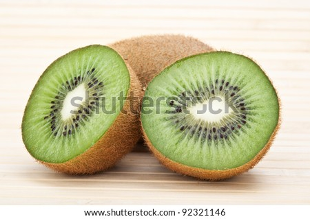 fresh green kiwi on a wooden background