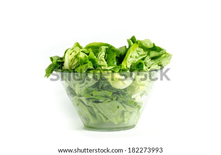 Fresh green leafs of lettuce in glass bowl